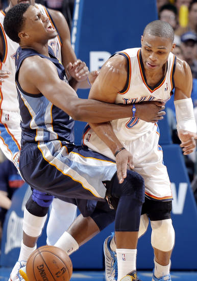 Memphis' Rudy Gay (22) collides with Oklahoma City's Russell Westbrook (0) during the NBA basketball game between the Oklahoma City Thunder and the Memphis Grizzlies at Chesapeake Energy Arena on Wednesday, Nov. 14, 2012, in Oklahoma City, Okla.   Photo by Chris Landsberger, The Oklahoman