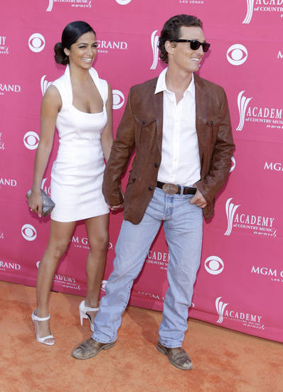 Matthew McConaughey and girlfriend Camila Alves arrive at the 44th Annual Academy of Country Music Awards in Las Vegas on Sunday, April 5, 2009. (AP Photo/Jae C. Hong) ORG XMIT: NVDC166