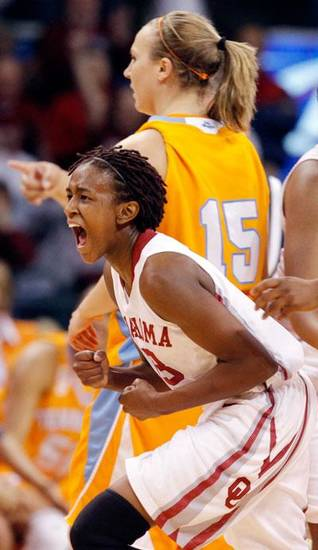 OU's Danielle Robinson (13) reacts in front of Tennessee's Alicia Manning (15) after a play in the first half of the women's college basketball game between Oklahoma and Tennessee at the Ford Center in Oklahoma City, Monday, February 2, 2009. BY NATE BILLINGS, THE OKLAHOMAN