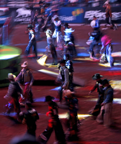 Riders make their way to the shoots after introductions during the WinStar World Casino Invitational PBR bull riding event at Chesapeake Energy Arena in Oklahoma City, Saturday, Jan. 26, 2013. Photo by Bryan Terry, The Oklahoman