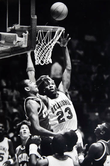 Former OU basketball player Wayman Tisdale. Sam Hill can't keep Wayman Tisdale from collecting two of his 33 points. Staff photo by Doug Hoke. Photo taken 2/13/1985, photo published 2/14/1985 in The Daily Oklahoman. ORG XMIT: KOD