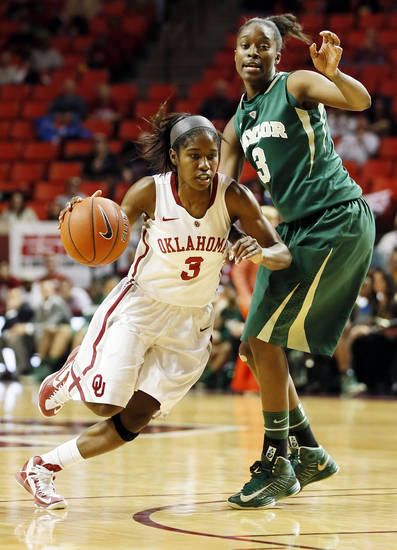 Oklahoma's Aaryn Ellenberg (3) drives past Baylor's Jordan Madden (3) during a women's college basketball game between the University of Oklahoma and Baylor at the Lloyd Noble Center in Norman, Okla., Monday, Feb. 25, 2013. Baylor beat OU, 86-64. Photo by Nate Billings, The Oklahoman