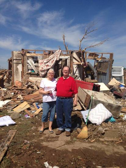 Barbara and Forrest Daniel, of Moore, stand in front of what?s left of their home of 30 years. They probably won?t ever go back to where their house once stood in Moore, their son Michael Daniel said Friday.  Photo by Michael Daniel