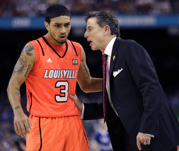 Louisville head coach Rick Pitino talks to guard Peyton Siva (3) during the second half of an NCAA Final Four semifinal college basketball tournament game Saturday, March 31, 2012, in New Orleans. (AP Photo/Mark Humphrey)
