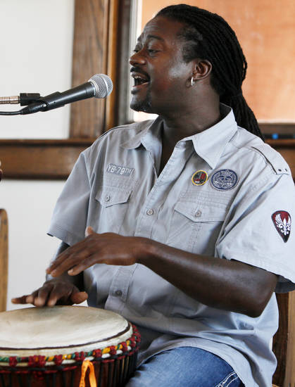 "Percussionist Arthur Thompson plays the djembe as he sings during a Jazz in June Clinic on ""The Tulsa Sound"" at the Santa Fe Depot, 200 S Jones Ave., in Norman, Okla., Saturday, June 23, 2012. Photo by Nate Billings, The Oklahoman"