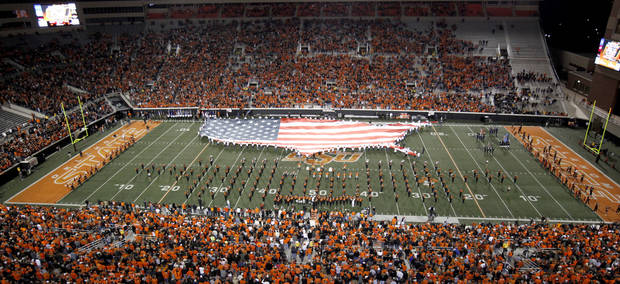 An American flag is brought out onto the field before the college football game between Oklahoma State University (OSU) and the University of Colorado (CU) at Boone Pickens Stadium in Stillwater, Okla., Thursday, Nov. 19, 2009. Photo by Bryan Terry, The Oklahoman