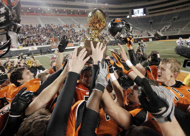 The Tonkawa Buccaneers raise the championship trophy after winning the Class A high school football state championship game between Tonkawa and Stroud at Boone Pickens Stadium in Stillwater, Okla., Saturday, Dec. 12, 2009. Tonkawa won, 7-6. Photo by Nate Billings, The Oklahoman