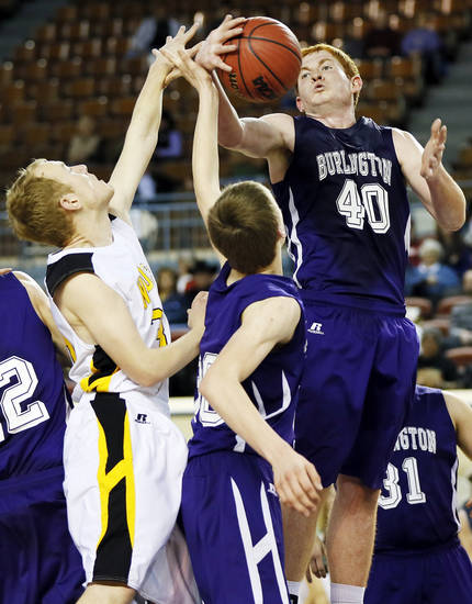 Burlington's Brandon Gosselin (40) grabs a rebound next to teammate Kyle Ellerbeck (30) and Arnett's Nicolas Smith (30) during a Class B Boys first-round game of the state high school basketball tournament between Burlington and Arnett at Jim Norick Arena, The Big House, on State Fair Park in Oklahoma City, Thursday, Feb. 28, 2013. Arnett won, 56-32. Photo by Nate Billings, The Oklahoman