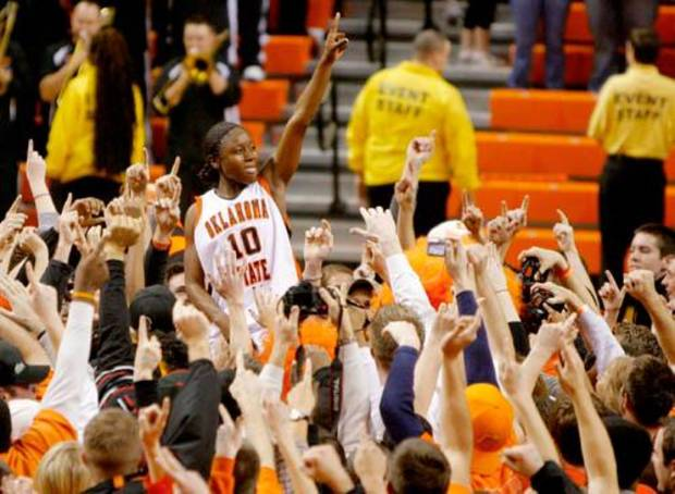 OSU's Andrea Riley (10) celebrates with the crowd following the women's Bedlam basketball game between Oklahoma State University and the University of Oklahoma at Gallagher-Iba Arena in Stillwater, Okla., Saturday, January 12, 2008. BY MATT STRASEN, THE OKLAHOMAN