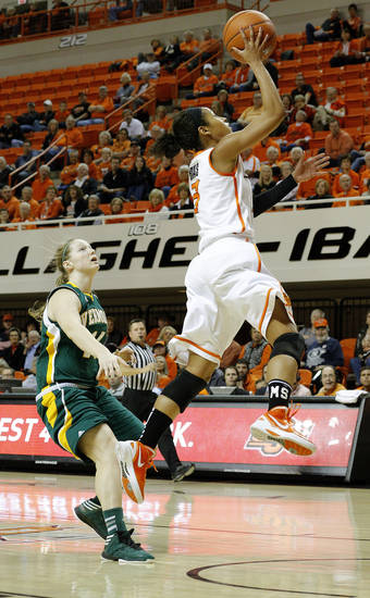 Oklahoma State's Tiffany Bias (3) shoots a lay up in front of Vermont's Niki Taylor (14) during the women's college basketball game between Oklahoma State University and Vermont at Gallagher-Iba Arena in Stillwater, Okla., Sunday,Dec. 16, 2012. Photo by Sarah Phipps, The Oklahoman