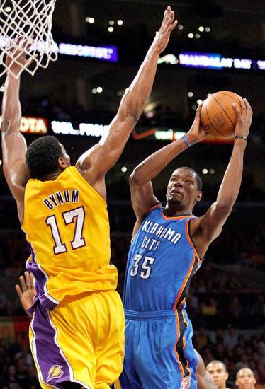 Oklahoma City's Kevin Durant (35) shoots as Los Angeles' Andrew Bynum (17) defends during Game 4 in the second round of the NBA basketball playoffs between the L.A. Lakers and the Oklahoma City Thunder at the Staples Center in Los Angeles, Saturday, May 19, 2012. Photo by Nate Billings, The Oklahoman
