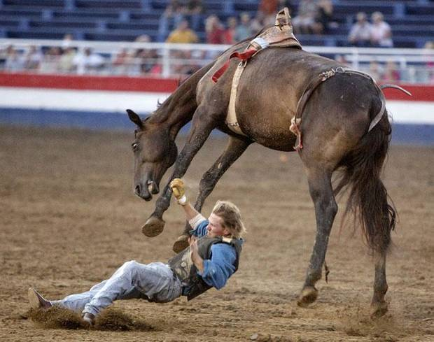 An inmate breaks his ankle as he falls off a horse during the Mad Scramble event at the Oklahoma State Prison Rodeo in McAlester, Okla., Friday, August 14, 2009. Photo by Bryan Terry, The Oklahoman ORG XMIT: KOD