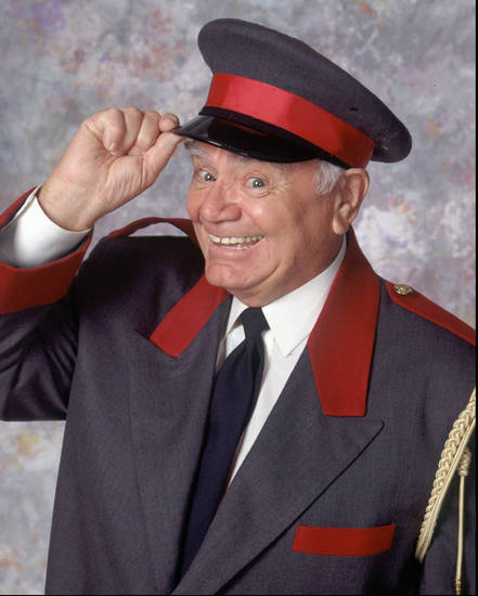 "NBC115 8/30/95 -- ""THE SINGLE GUY"" - Series Premiere:  Thursday, September 21  (8:30-9p.m. E.T.) --- PICTURED: Ernest Borgnine  --- ERNEST BORGNINE RETURNS TO SERIES TV -- Oscar winner Ernest Borgnine (""Marty,"" ""McHale's Navy"") returns to series TV a Manny, a lovable doorman working at Johnny Eliot's (Jonathan Silverman) New York City apartment.  As a husband, father and grandfather, Manny provides perspective for single guy Johnny on his roller coaster ride of blind dates, ""fix-ups"" and romantic adventures.  -- NBC PHOTO BY: Dave Bjerke."