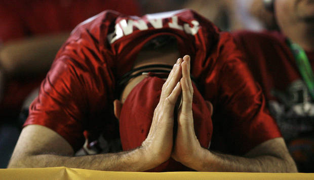 A Sooner fan reacts to the Sooners 24-14 loss to Florida during the second half of the BCS National Championship college football game between the University of Oklahoma Sooners (OU) and the University of Florida Gators (UF) on Thursday, Jan. 8, 2009, at Dolphin Stadium in Miami Gardens, Fla. Oklahoma lost the game 24-14 to the Gators.  PHOTO BY CHRIS LANDSBERGER, THE OKLAHOMAN