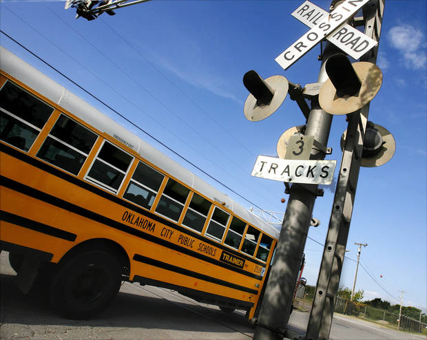 Bus drivers practice approaching and crossing railroad tracks at the district's transportation center in northeast Oklahoma City, Thursday,  Aug. 7, 2008.   BY JIM BECKEL, THE OKLAHOMAN