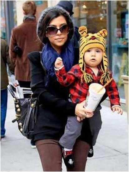 Kourtney Kardashian with son Mason Disick in Elaine et Lena plaid shirt.