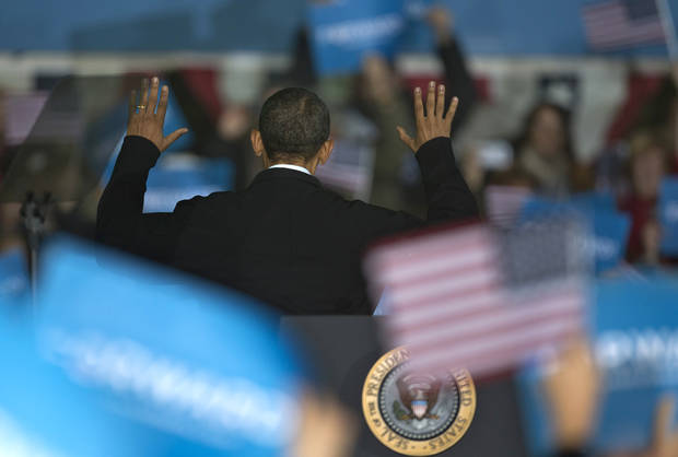 President Barack Obama turns to acknowledge supporters behind him after speaking at a campaign event at the Franklin County Fairgrounds, Friday, Nov. 2, 2012, in Hilliard, Ohio, before heading to another campaign stop in in Springfield, Ohio. (AP Photo/Carolyn Kaster)
