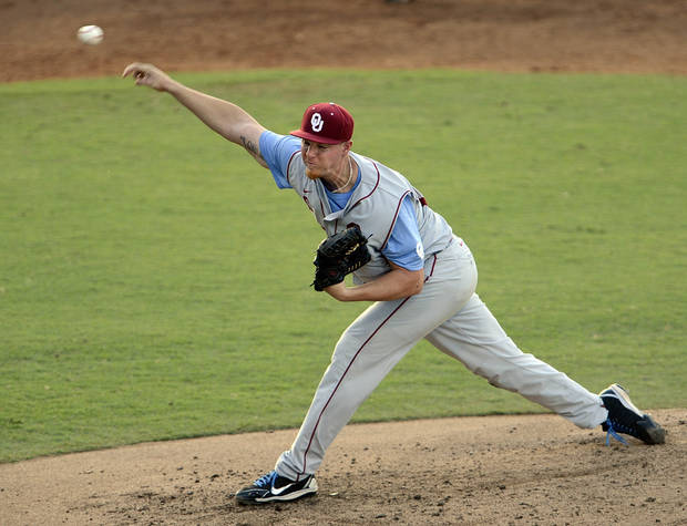 Oklahoma pitcher Jonathan Gray fires to the plate during the third inning of an NCAA college baseball tournament regional game against LSU, Friday, June 7, 2013, in Baton Rouge, La. LSU won 2-0. (AP Photo/Bill Feig) ORG XMIT: LABF107