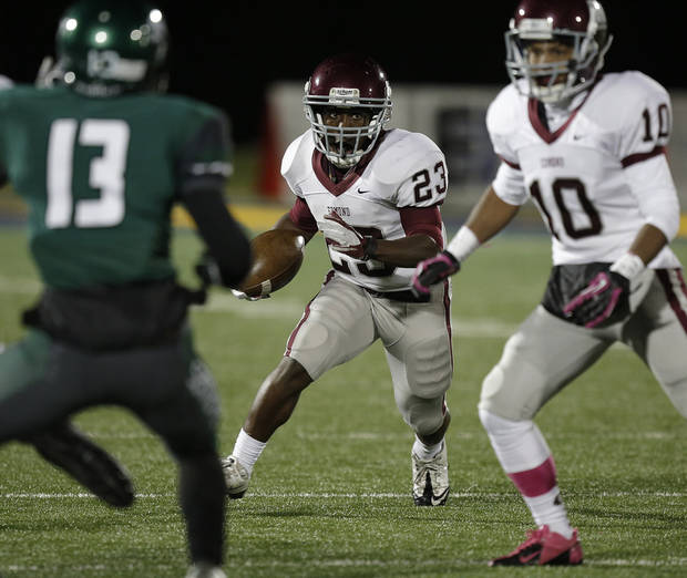 Memorial's Waylan Anderson (23) runs the ball during a high school football game between Edmond Memorial and Edmond Santa Fe at Wantland Stadium in Edmond, Okla., Friday, Oct. 26, 2012.  Photo by Garett Fisbeck, The Oklahoman