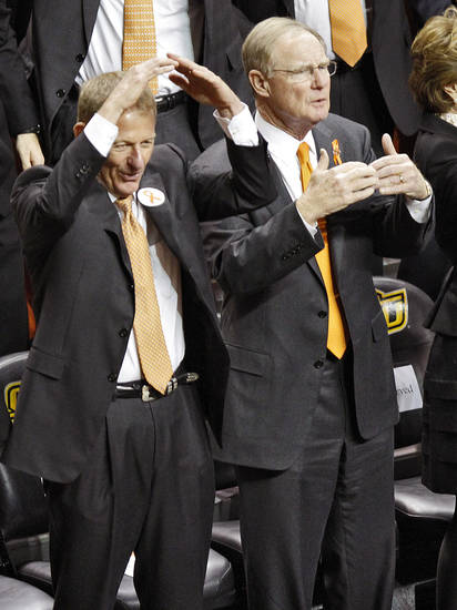 Oklahoma State athletic director Mike Holder and school president Burns Hargis jester while singing the alma mater during the memorial service for Oklahoma State head basketball coach Kurt Budke and assistant coach Miranda Serna at Gallagher-Iba Arena on Monday, Nov. 21, 2011 in Stillwater, Okla. The two were killed in a plane crash along with former state senator Olin Branstetter and his wife Paula while on a recruiting trip in central Arkansas last Thursday. Photo by Chris Landsberger, The Oklahoman