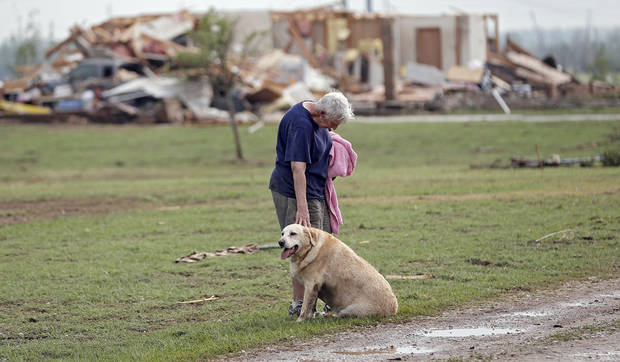 Kay Taylor stands with her dog Bailey in front of her house that was destroyed after the tornado that hit the area near 149th and Drexel on Monday, May 20, 2013 in Oklahoma City, Okla.  Photo by Chris Landsberger, The Oklahoman