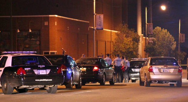 Police investigate a scene of shooting with multiple victims near Reno Avenue and Mickey Mantle Drive in Bricktown early Tuesday, 22, 2012 in Oklahoma City. Photo by Sarah Phipps, The Oklahoman