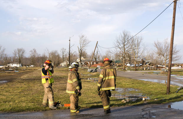 Clean-up crews survey the tornado damage to homes Friday, March 2, 2012 in Marysville, Ind. Powerful storms stretching from the U.S. Gulf Coast to the Great Lakes in the north wrecked two small towns, killed at least three people and bred anxiety across a wide swath of the country on Friday, in the second deadly tornado outbreak this week. (AP Photo/Brian Bohannon) ORG XMIT: KYBB113