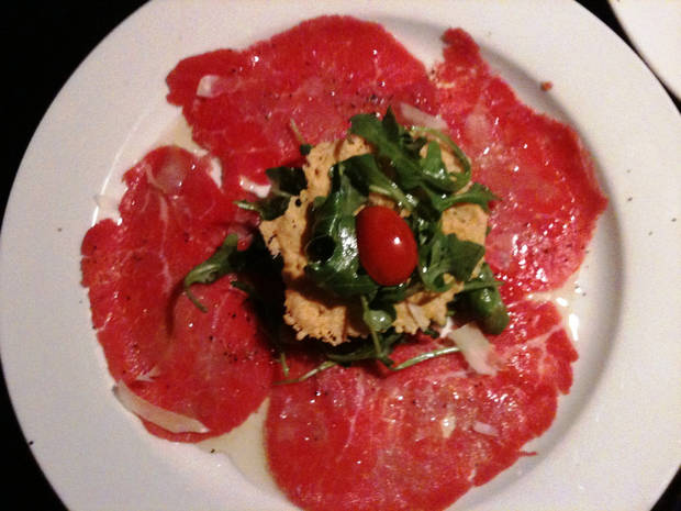 Beef Carpacio with arugula salad.