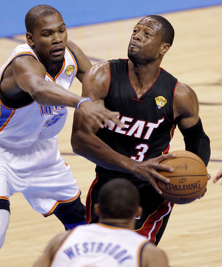 Miami's Dwyane Wade (3) goes past Oklahoma City's Kevin Durant (35) during Game 2 of the NBA Finals between the Oklahoma City Thunder and the Miami Heat at Chesapeake Energy Arena in Oklahoma City, Thursday, June 14, 2012. Photo by Chris Landsberger, The Oklahoman