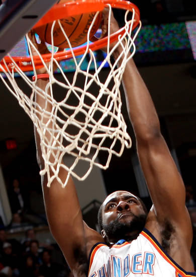 Oklahoma City's James Harden slams in two points against Philadelphia during the first half of their NBA basketball game at the Ford Center in Oklahoma City on Tuesday, Dec. 2, 2009. By John Clanton, The Oklahoman