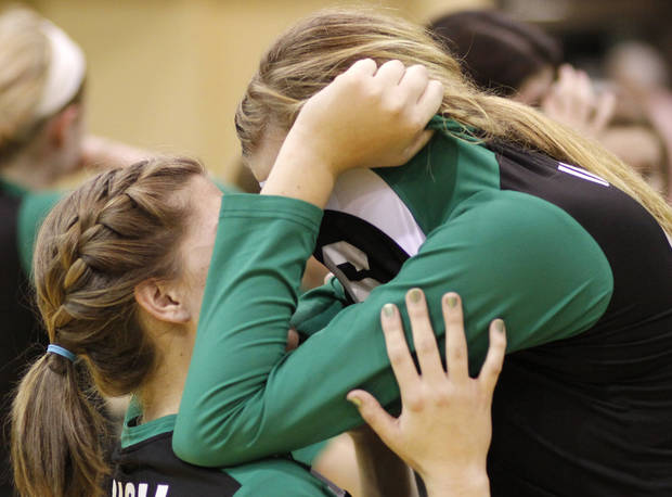 Irish Mary Kate Roy, left, talks to Emily Oliphant after their loss in the finals during the 5A Volleyball state championship game between Bishop McGuinness and Bishop Kelley at Oklahoma Baptist University in Shawnee Saturday, Oct. 16, 2010. Photo by Doug Hoke, The Oklahoman