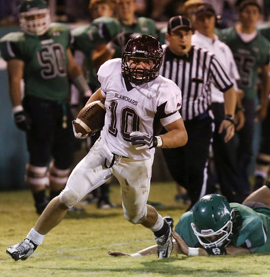 Blanchard running back Braden Stringer leaves a Jones defender face-down in the turf as he goes along the sideline on a run to the right side of the field to score his team's second touchdown.  Blanchard vs. Jones high school football at Jones  High School on Friday, Oct. 12, 2012.   Photo by Jim Beckel, The Oklahoman
