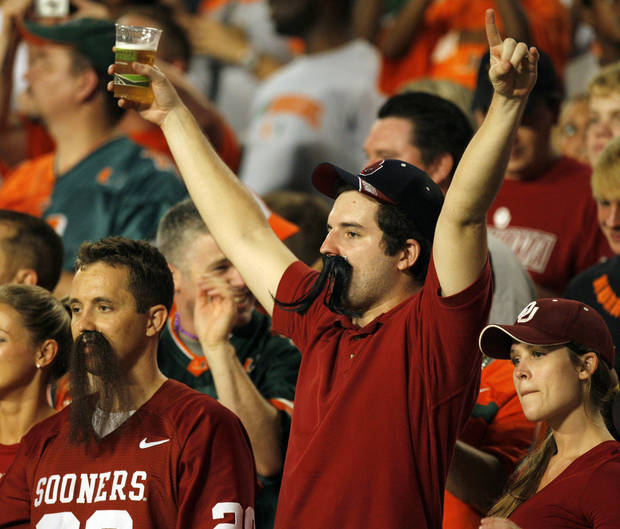 OU fans and brothers Brandon Cathey, left, and Ryan Cathey, right, wear false mustaches to show support for quarterback Landry Jones during the college football game between the University of Oklahoma (OU) Sooners and the University of Miami (UM) Hurricanes at Land Shark Stadium in Miami Gardens, Florida, Saturday, October 3, 2009. Photo by Nate Billings, The Oklahoman