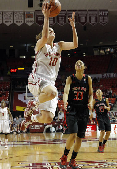Oklahoma Sooner's Morgan Hook (10) drives to the basket on a fast break as Tech's Shauntal Nobles (33) watches as the University of Oklahoma Sooners (OU) play the Texas Tech Lady Red Raiders in NCAA, women's college basketball at The Lloyd Noble Center on Saturday, Jan. 12, 2013 in Norman, Okla. Photo by Steve Sisney, The Oklahoman