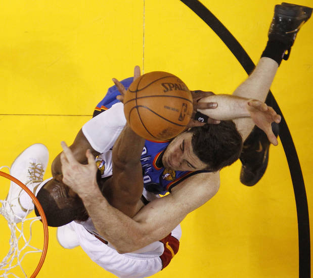 Miami Heat shooting guard Dwyane Wade (3) tries to block a shot by Oklahoma City Thunder power forward Nick Collison, right, during the first half at Game 3 of the NBA finals basketball series, Sunday, June 17, 2012, in Miami. (AP Photo/Mike Segar, Pool)  ORG XMIT: NBA140