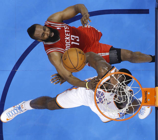 Houston's James Harden (13) and Oklahoma City's Kendrick Perkins (5) battle under the basket during Game 2 in the first round of the NBA playoffs between the Oklahoma City Thunder and the Houston Rockets at Chesapeake Energy Arena in Oklahoma City, Wednesday, April 24, 2013. Photo by Chris Landsberger, The Oklahoman