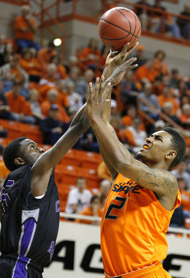 Oklahoma State's Le'Bryan Nash (2) shoots as Central Arkansas' Daouda Berete (25) during the men's college basketball game between Oklahoma State University and Central Arkansas at Gallagher-Iba Arena in Stillwater, Okla., Sunday,Dec. 16, 2012. Photo by Sarah Phipps, The Oklahoman