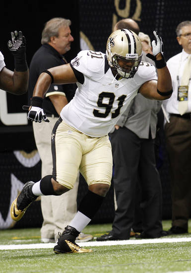 FILE - This Sept. 9, 2012 file photo shows New Orleans Saints football defensive end Will Smith (91) warming up before an NFL football game in New Orleans. Former NFL Commissioner Paul Tagliabue and lawyers for the league and the players' union have arrived on Capitol Hill in Washington, Thursday for a hearing in the Saints bounties case. Tagliabue is overseeing the latest round of player appeals in Washington. Smith and fellow player Jonathan Vilma, who were suspended said they plan to attend. (AP Photo/Bill Haber, File)