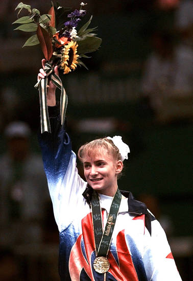 Shannon Miller, of Edmond, Okla, acknowledges the crowd after being awarded the gold medal in the balance beam during the women's individual event gymnastics finals at the Centennial Summer Olympics Games in Atlanta Monday, July 29, 1996.  (AP Photo/Susan Ragan)
