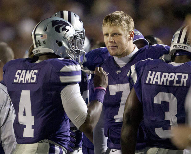 Kansas State quarterback Collin Klein (7) gives a look to quarterback Daniel Sams (4) during the second half of an NCAA college football game in Manhattan, Kan., Saturday, Nov. 3, 2012. Sams replaced Klein in the fourth quarter. Kansas State defeated Oklahoma State 44-30. (AP Photo/Orlin Wagner)