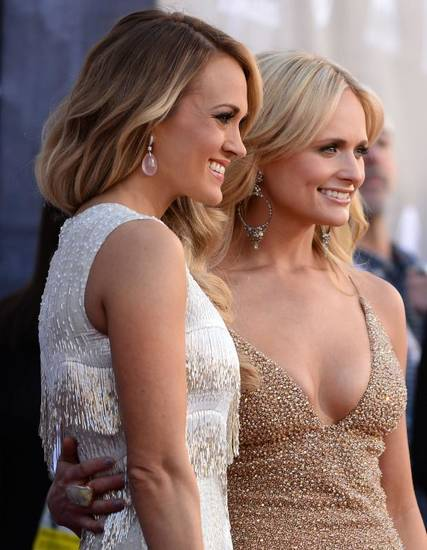 Carrie Underwood, left, and Miranda Lambert arrive at the 49th annual Academy of Country Music Awards at the MGM Grand Garden Arena on Sunday, April 6, 2014, in Las Vegas. (AP)