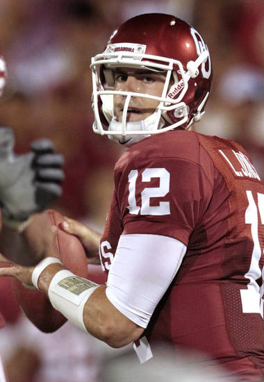 Oklahoma's Landry Jones (12) passes for a touchdown during the college football game between the University of Oklahoma Sooners (OU) and the University of Missouri Tigers (MU) at the Gaylord Family-Memorial Stadium on Saturday, Sept. 24, 2011, in Norman, Okla. Photo by Steve Sisney, The Oklahoman