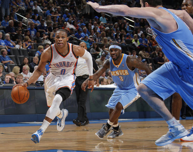 Oklahoma City's Russell Westbrook (0) drives the ball up the court past Denver's Ty Lawson (3) during the NBA preseason basketball game between the Oklahoma City Thunder and the Denver Nuggets at the Chesapeake Energy Arena, Sunday, Oct. 21, 2012. Photo by Garett Fisbeck, The Oklahoman