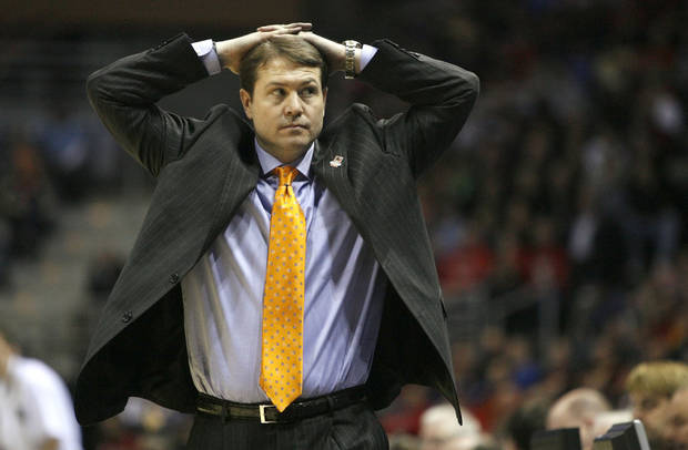 OSU head coach Travis Ford walks by the bench during the first round of the NCAA men's basketball tournament between Oklahoma State University and Georgia Tech at the Bradley Center in Milwaukee, Friday, March 19, 2010.   Photo by Bryan Terry, The Oklahoman