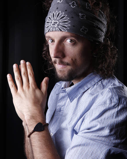 In this March 8, 2012 photo, musician Jason Mraz poses for a portrait in New York. The singer-songwriter, known for feel-good and hippie hits like �I'm Yours� and �The Remedy (I Won't Worry),� released his latest album �Love Is a Four Letter Word,� on Tuesday. (AP Photo/Carlo Allegri)