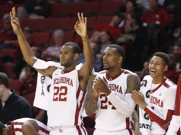Oklahoma forward Amath M'Baye (22), forward Romero Osby (24) and guard Isaiah Cousins (11) cheer following an Oklahoma basket in the first half of an NCAA college basketball game against TCU in Norman, Okla., Monday, Feb. 11, 2013. (AP Photo/Sue Ogrocki)