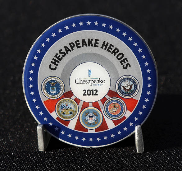 About 200 employees at Chesapeake Energy received commemorative coins (one side shown here) during a Veterans Day ceremony Monday afternoon, Nov. 12, 2012, on the company's campus in northwest Oklahoma City. The employees were recognized for their military service to the nation. Keynote speaker was Maj. Gen. Rita Aragon (ret.),  who is Oklahoma secretary of military and veterans affairs.  A company spokesperson said a total of nearly 1200 employees will receive the coin and be commended for military service.   Photo by Jim Beckel, The Oklahoman