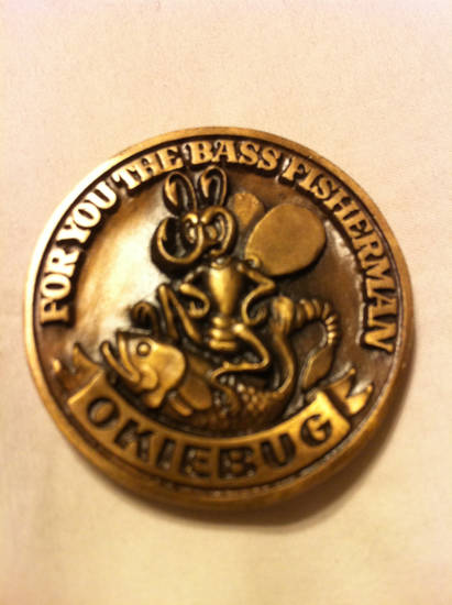 The front of the Okiebug coin