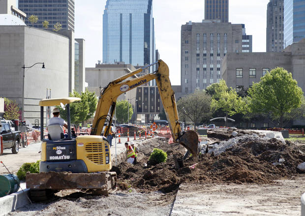 Construction crews clear the Civic Center park as part of a controversial make-over designed by architect Rand Elliott and Tulsa-based landscape architecture firmn PDG Inc. <strong>PAUL HELLSTERN - Oklahoman</strong>