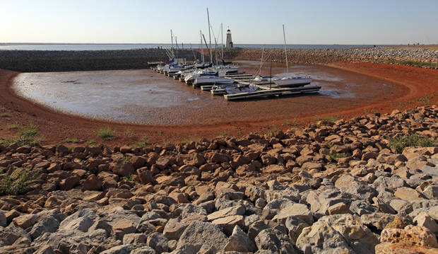 Boats rest in mud in a cove on the east side of Lake Hefner because of low water levels caused by drought in Oklahoma City, Monday, Oct. 3, 2011. Photo by Nate Billings, The Oklahoman  ORG XMIT: KOD